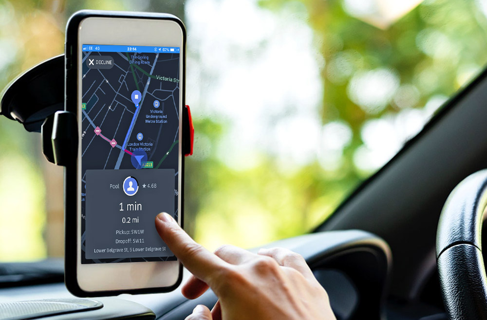 uber driver using phone for gps in PCO car