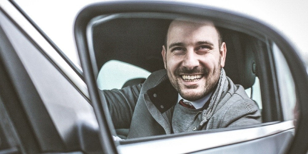 PCO driver smiling in PCO car